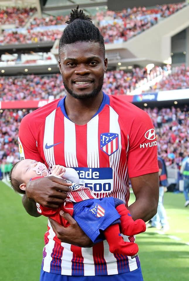 Atletico Madrid star Thomas Partey outdoors beautiful baby daughter at Wanda Metropolitano