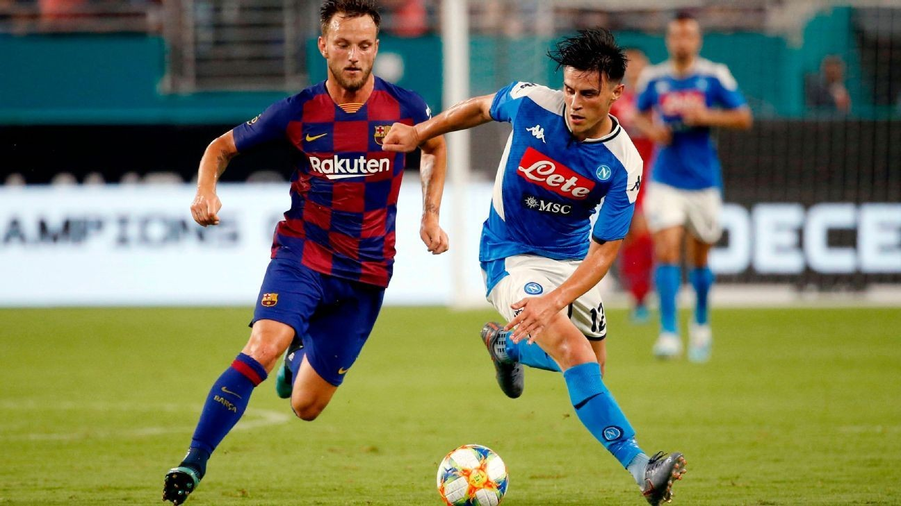 Rakitic, Busquets score as Barca beat Napoli