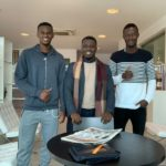 FIFA agent Oliver Arthur bonds with clients Carl Davordzie and Ahmed Awuah of Parma