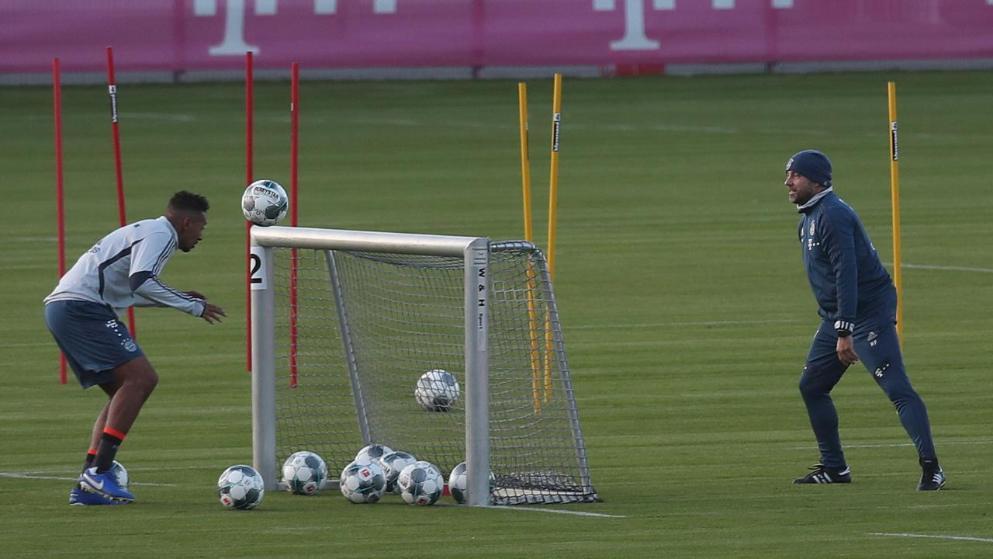 Bayern Munich defender Jerome Boateng trains alone