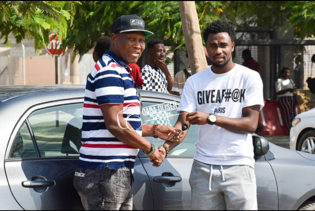 PHOTOS: Samuel Tetteh donates 'tear rubber' Toyota Corolla to long-time manager EazyMan Nevis