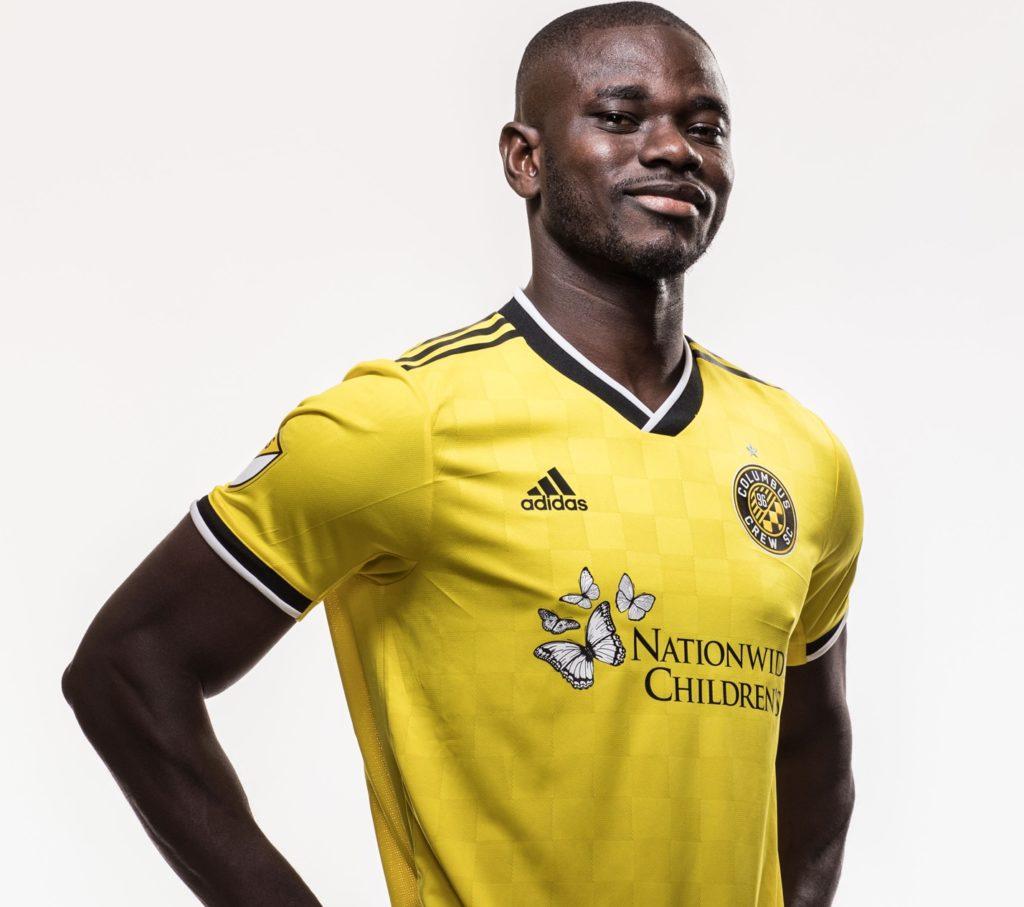 PHOTOS: Jonathan Mensah models as Columbus Crew outdoor new jersey sponsor