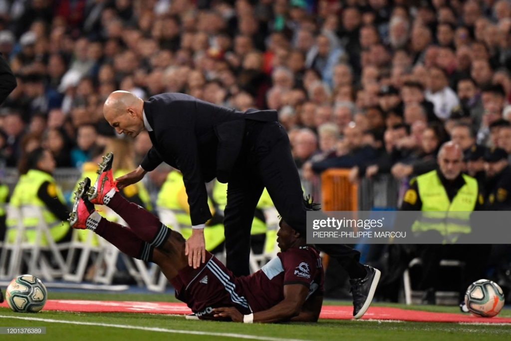 PHOTOS: Ghana defender Joseph Aidoo takes out Zinedine Zidane on the sidelines