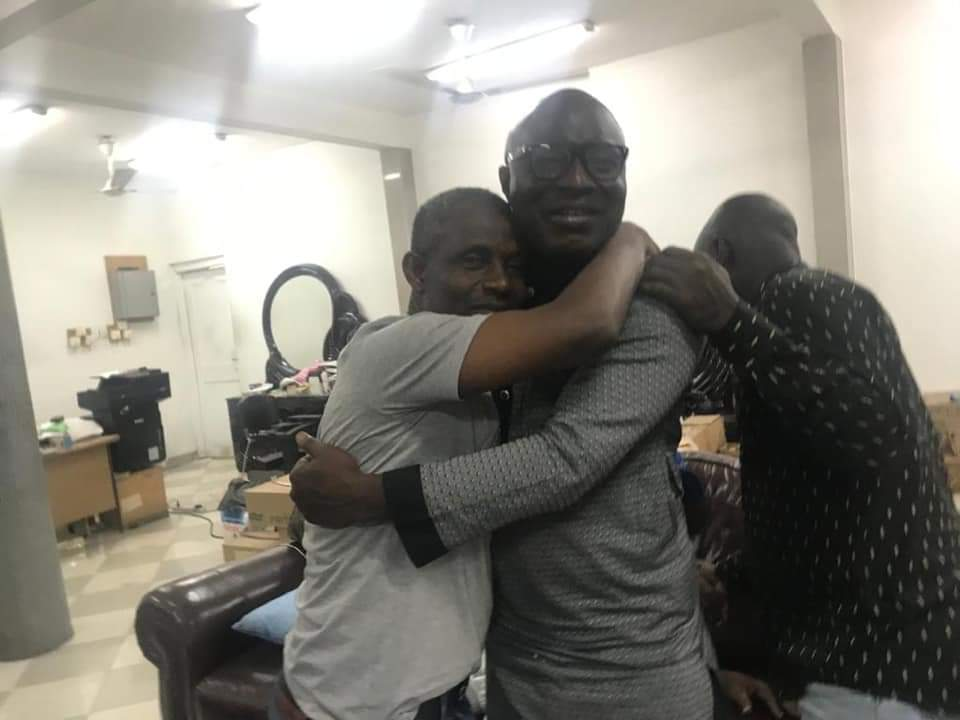 Lamptey and Jiji hugging after ending their dispute