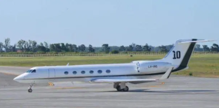 Messi's private jet with family names on steps, No 10 on tail & 2 bathrooms