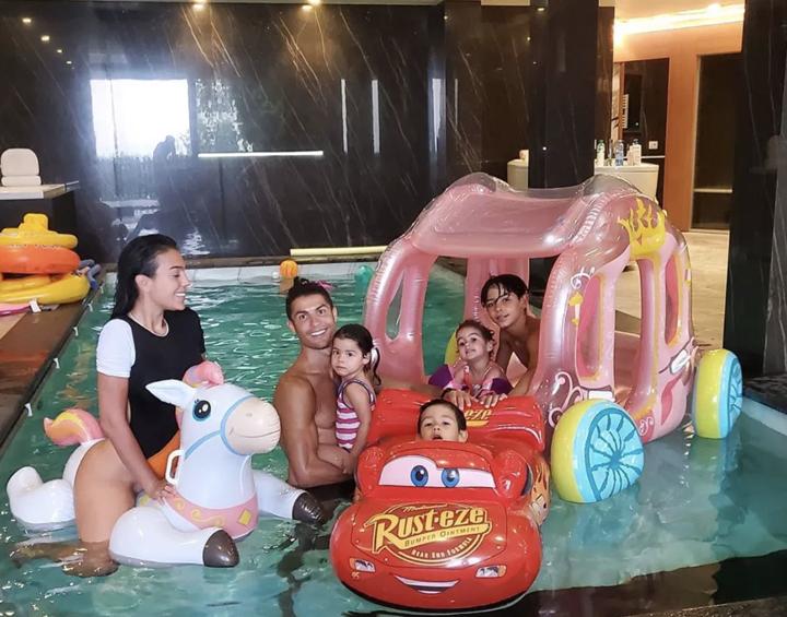 Ronaldo strips off for family swim as Georgina rides unicorn