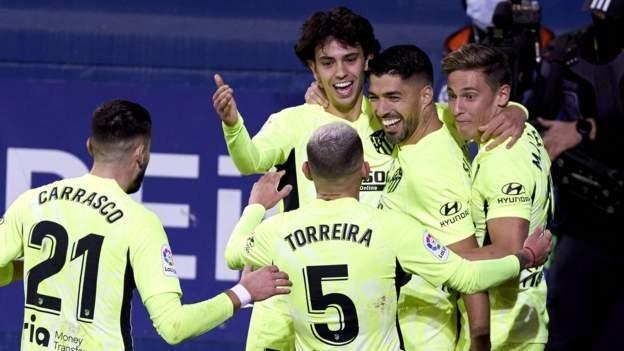Suarez sends Atletico seven points clear
