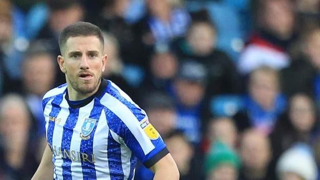 Wednesday re-sign defender Hutchinson
