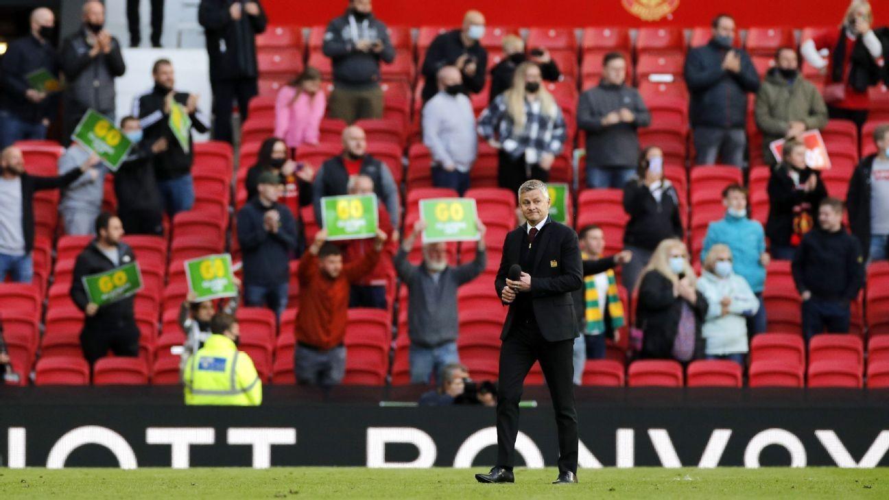 Returning Man Utd fans cheer, protest, but Solskjaer has concerns